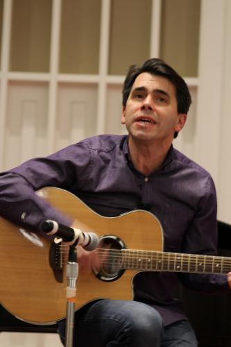 """Musician Jim Allyn opened the gathering with """"Free To Be You And Me,"""" a perfect song, which he described as one of his wife's favorites.  (Bee Photo, Hicks0"""