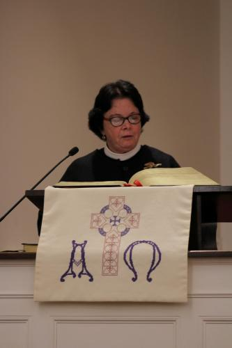 Trinity Episcopal Church Rector Kathie Adams-Shepherd was the first guest clergy member to speak during the Newtown Interfaith Thanksgiving Gathering on Sunday evening.  (Bee Photo, Hicks)