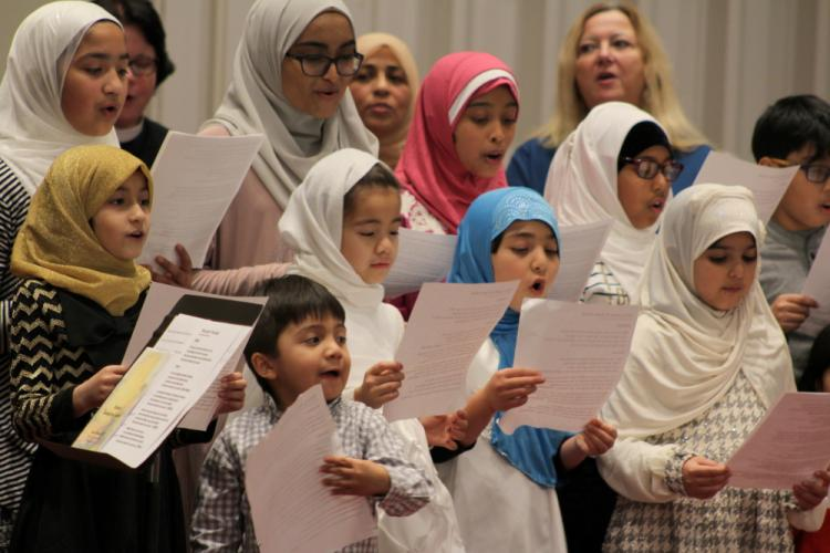 Eleven young members of Al Hedaya Islamic Center made up a children's choir for the 2016 Interfaith Thanksgiving Gathering.  (Bee Photo, Hicks)
