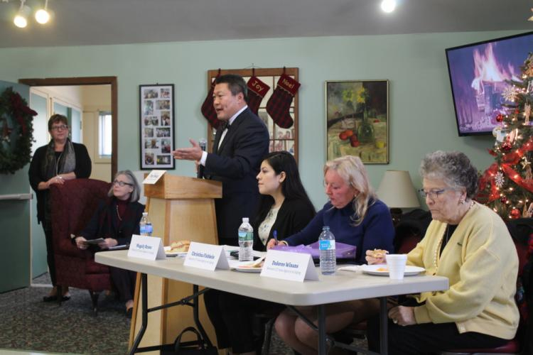 State Senator Tony Hwang, standing at the podium, moderated a Lunch & Learn panel discussion at Newtown Senior Center on Friday, December 8. While the program had initially been scheduled to cover a number of topics, huge cuts to the Medicare…
