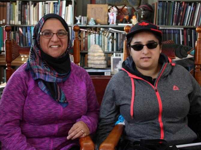 Sabeena Ali and her oldest daughter Ayesha, in the office of <i>Newtown Bee </i>Publisher Scudder Smith in February. While Muslims around the world continue to find themselves at the center of heated social and political debates and attacks, the two…