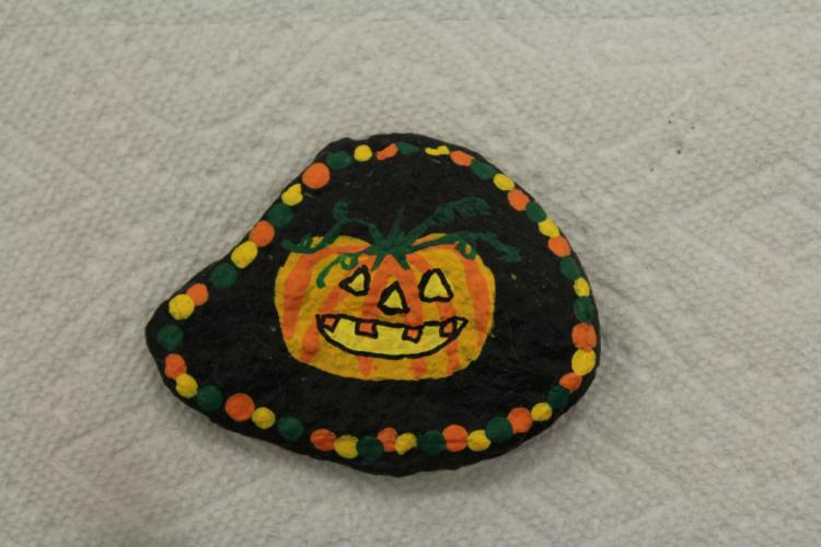 A seasonal painted rock created by one of the residents of Nunnawauk Meadows, this jack-o'-lantern will be hidden somewhere in Newtown.  (Bee Photo, Hicks)