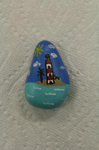 Another rock created during a Tuesday afternoon painting session at Nunnawauk Meadows featured a serene lighthouse scene.  (Bee Photo, Hicks)