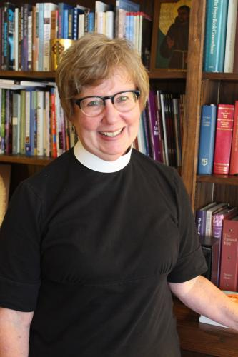 The Reverend Dr Jenny Montgomery, who is serving as priest-in-charge at Trinity Episcopal Church, is working with members of the Main Street church to embrace new ways of keeping the church relevant while also honoring Episcopalian tradition.  (Bee…