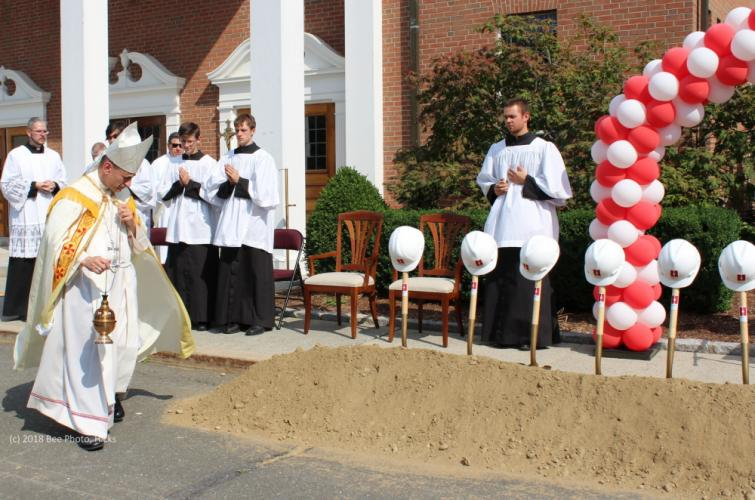 SH_St-Rose-groundbreaking-10-Caggiano-begins-to-bless-ground.jpg