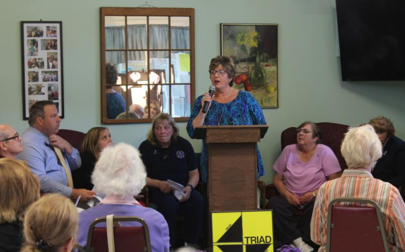 Director of Senior Services Marilyn Place hosted a TRIAD program at Newtown Senior Center on September 30, when ten speakers offered tips to local senior citizens on recognizing and preventing elder abuse.  (Bee Photo, Hicks)