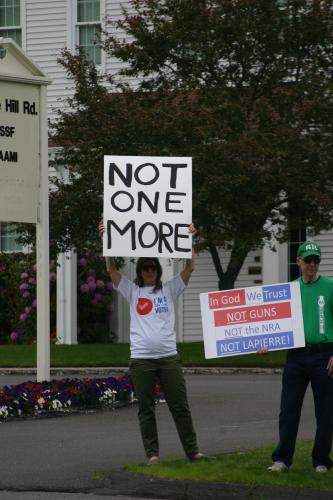 One of the organizers of a peaceful demonstration outside the headquarters of National Shooting Sports Foundation on May 30, Kate Mayer held a sign with a message that has spread across the country during the past week: Not One More.
