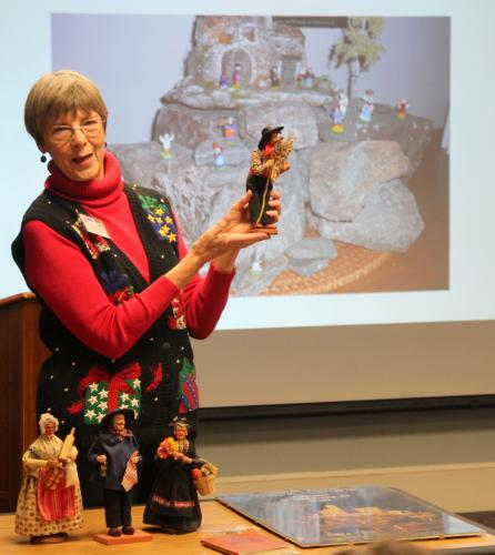 Lynda DeLuryea holds up a santon representing the late French actor Yves Montand. Mrs DeLuryea was one of the guest speakers during the Genealogy Club of Newtown's holiday gathering on December 13. On the table in front of her are three additional…