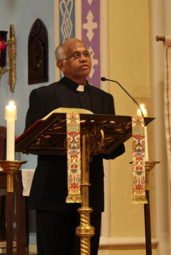 Father Alphonse Arokiam, a parochial vicar with St Rose of Lima Roman Catholic Church, offered the evening's Blessing and Benediction.  (Bee Photo, Hicks)