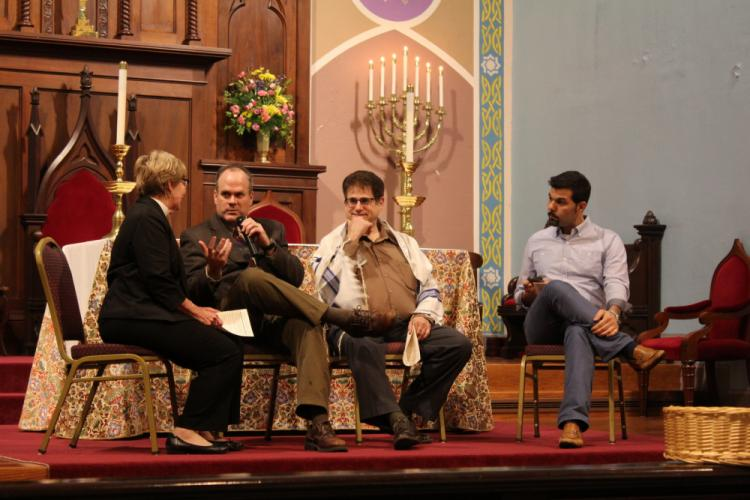 Reverend Matt Crebbin makes a point during the conversation segment of the Newtown Interfaith Thanksgiving Service. Celebrated on November 19 at Trinity Episcopal Church, the hourlong service was a celebration of multiple faiths and Thanksgiving…