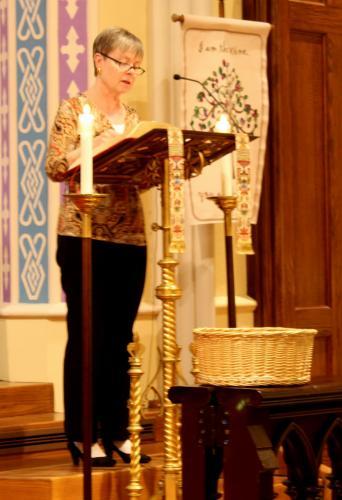 Newtown United Methodist Church Senior Pastor Lori Miller did a reading from Christian Scripture.  (Bee Photo, Hicks)