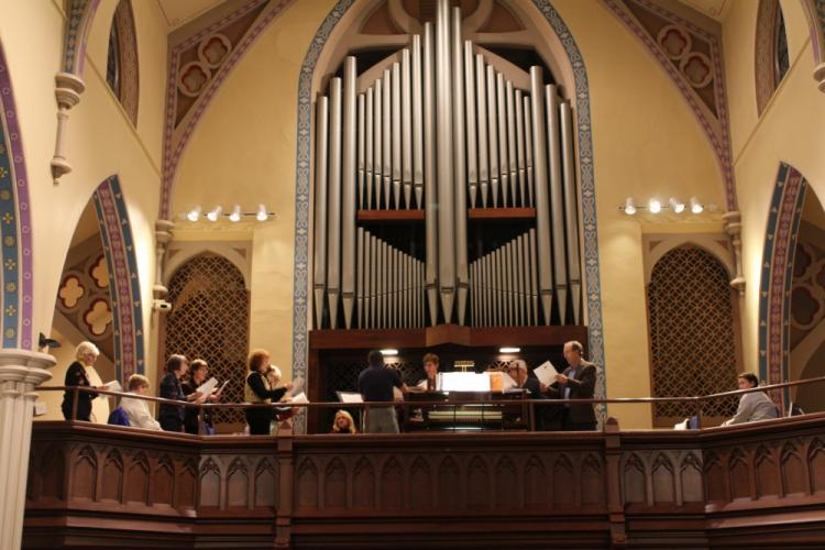 An interfaith choir was directed by Trinity Director of Music Ministry Don Wisman.  (Bee Photo, Hicks)