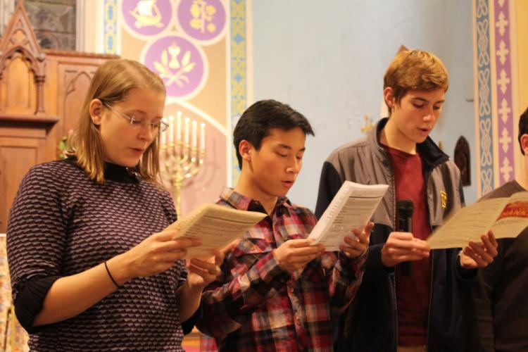 Trinity Curate Carrie Combs, on the left, invited young adults at the service to help her lead the Litany of Thanksgiving. Among those who joined her were Jack Wojtowicz, center, and Rick Irving.  (Bee Photo, Hicks)