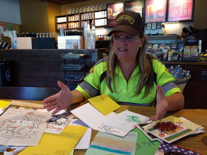 Kat Holick looks over just a small sampling of notecards and letters she has received from children and adults since taking on the role of one of Newtown's traffic agents. Ms Holick, who has become something of a celebrity thanks to the positive…