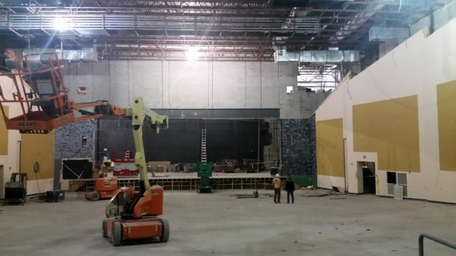 A photo taken on Thursday, March 30, shows two workers standing in front of the stage in the Newtown High School auditorium as renovation work is underway. The school board heard an update on the project at its meeting on Tuesday, April 4.