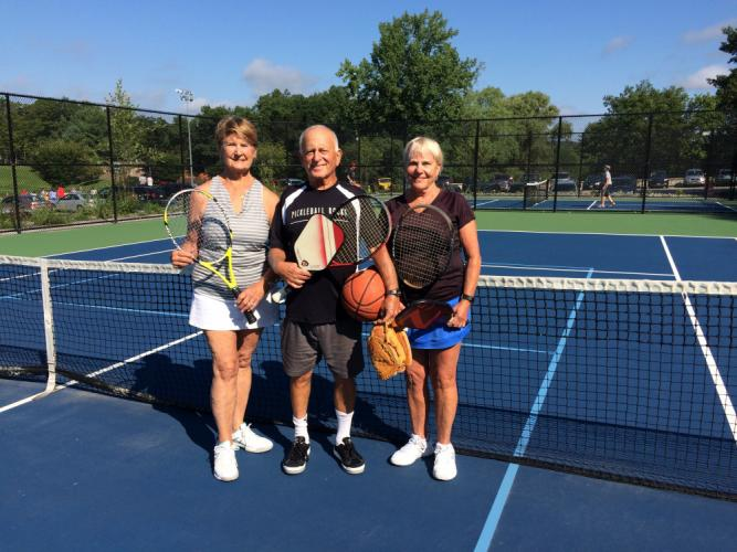 Diana Johnson, Larry Haskel, and Sonja Haskel play several sports to stay active.