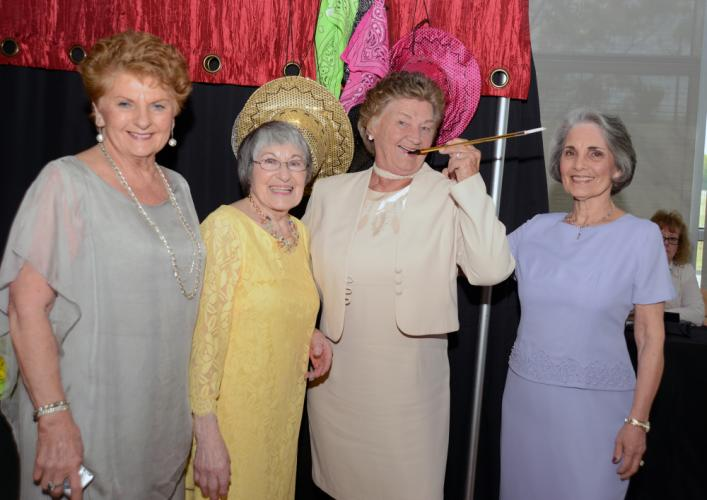 Dottie Dellapiano, Rose West, Pat Armstrong, and Marianne Corbo dress up at the photo booth.