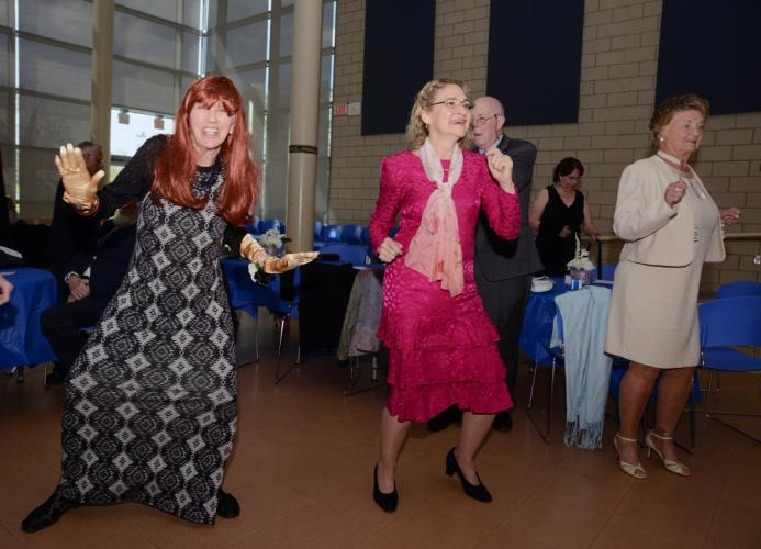 Margaret Walsh and Anna Marie DeMattei enjoy the music during the recent senior citizen prom.