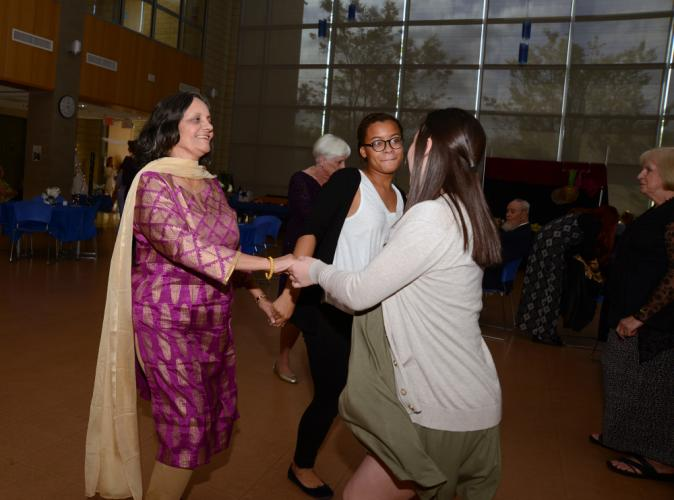 """During the recent Senior Citizen Prom, """"A Night In Paris,"""" on May 12, Sudha Gupta, left, shares a dance with Ben's Lighthouse students Marisa Choi, right, and Danielle Johnson.  (Bee Photo, Bobowick)"""