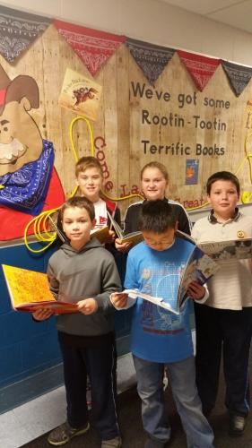 St Rose of Lima School students stand with books as a preview for the school's Scholastic Book Fair. Pictured in the front are Christopher Setear, left, and Kyan Milo. In the back from left are Nick Prieto, Caleigh Prieto, and Thomas Setear.