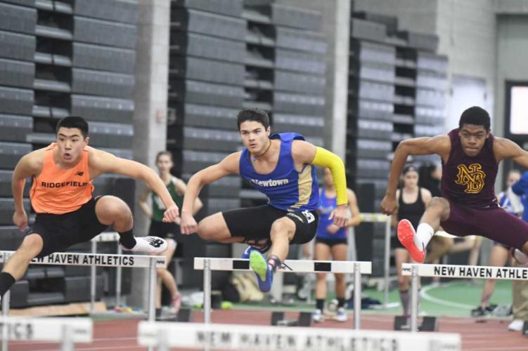 Brett Deri placed third in the 55 hurdles during the state championship meet. (Krista Benson photo)