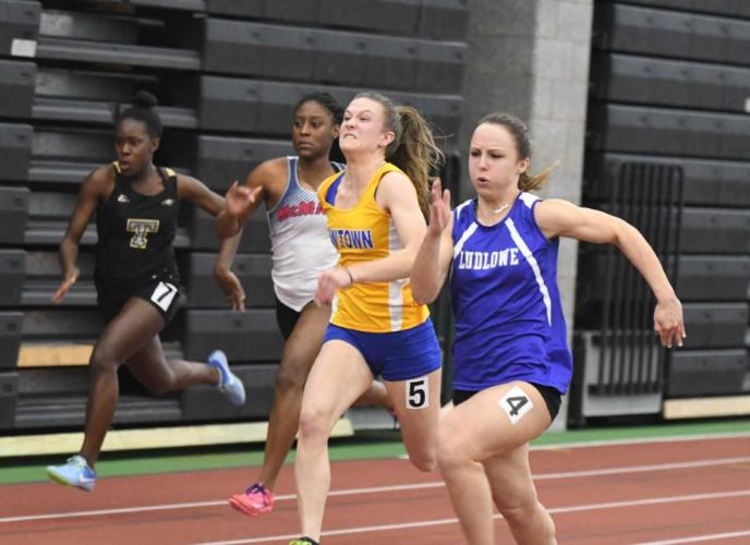 Carly Swierbut, center, was second in the 100 meter dash and ninth in the 200. (Krista Benson photo)