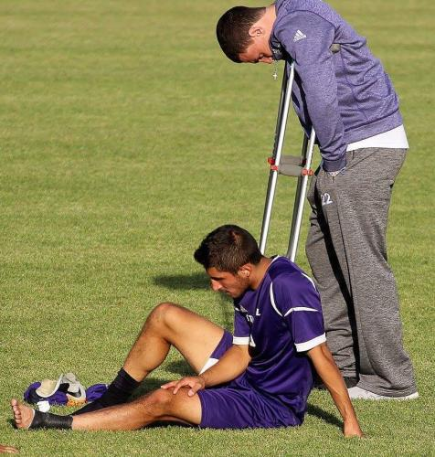 Former Stonehill College soccer teammate Drew Montano is pictured sitting with Stephen Conway as he leans on crutches following a 2015 foot injury. Mr Conway eventually recovered to the extent that he was able to play in his senior season in 2016…