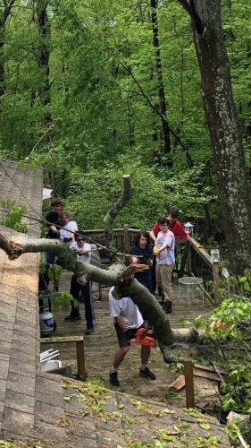 Newtown High School marching band members and friends joined together to help member Dom Pasquarella and family clear trees from their Butterfield home.  -photo courtesy of Thomas Hasselberger