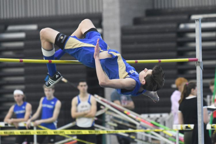 Zach Crebbin clears 6-foot-2 to place second in the high jump event at the SCC meet. (Krista Benson photo)