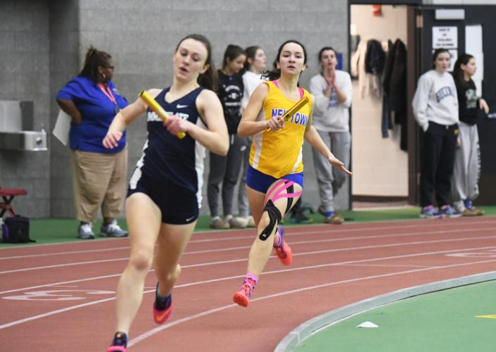 Jackie O'Leary runs in the 4x400 which placed second. Other members of the 4x400 were Sarah Houle, Grace Pattenelli, and Carly Swierbut. (Krista Benson photo)