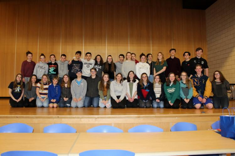 During the delegation from France's visit, French students and Newtown students pose together for a photo on the stage in the high school's cafetorium.