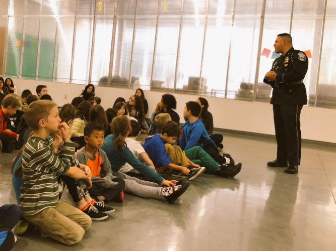 Newtown Police Department Security Resource Officer Rich Monckton shares information about his time in the army with students at Fraser Woods Montessori School on November 10. (Chris Robertson photo)