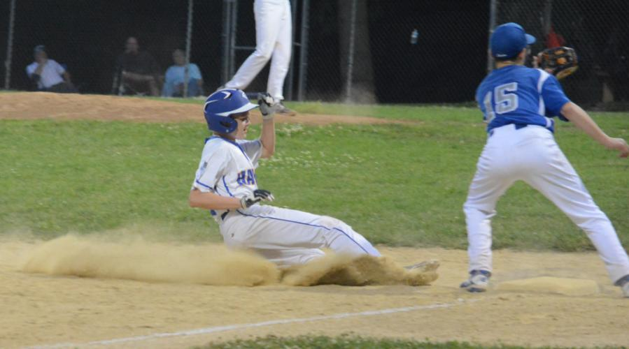 Steven Cotton slides safely into third base as the Hawgs battle Darien in the state playoffs. (Bee Photo, Hutchison)