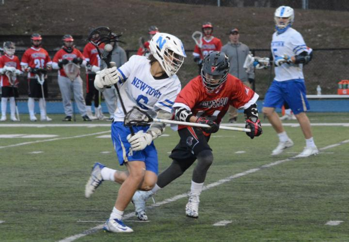 Jeff Garrity runs with the ball during Newtown's 17-5 win over Pomperaug. (Bee Photo, Hutchison)