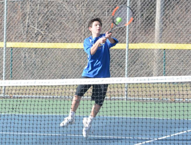 Ben Futterman hits a return. (Bee Photo, Hutchison)