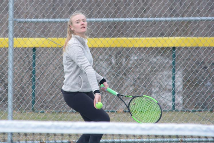 Julia Anderson prepares to serve the ball into play. (Bee Photo, Hutchison)