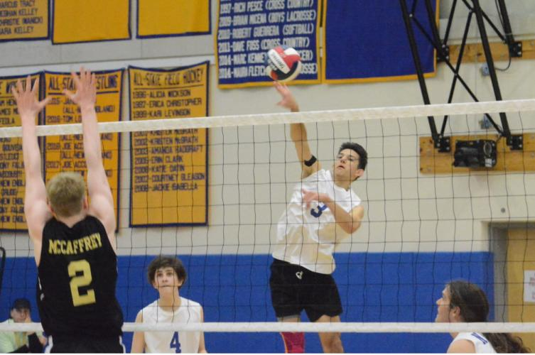 Ardi Kodzodziku sends the ball over the net. (Bee Photo, Hutchison)