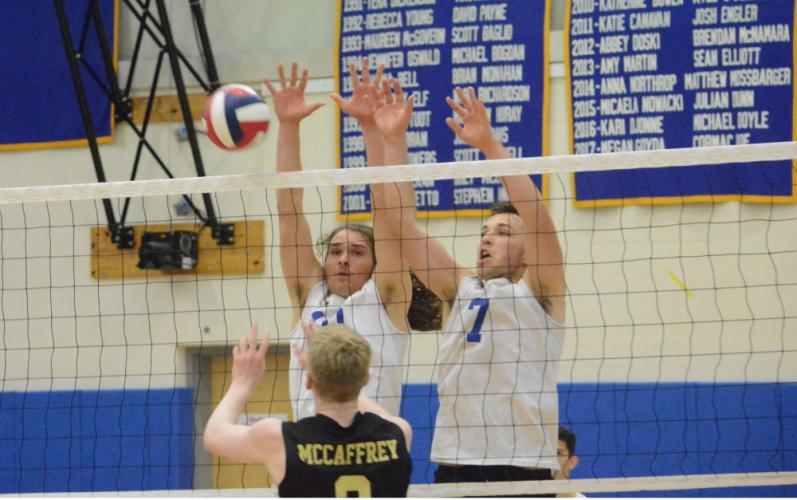 Silas Decker, left and Robbie Morrill go up for a block during Newtown's win over Barlow. (Bee Photo, Hutchison)
