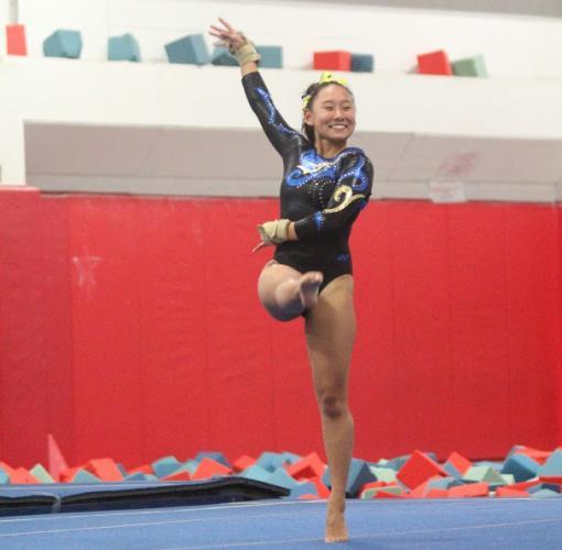 Emma Delia competes on the floor. (Chris Jannott photo)