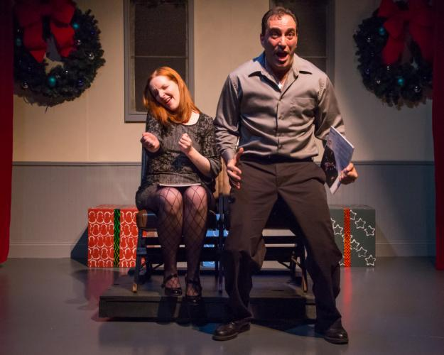 Carey van Hollen (left) and Alexis Vournazos have very different experiences watching the Rockettes, in a scene from <i>Wreck The Halls.</i> Newtown Bee Theater Reviewer Elizabeth Young calls the holiday revue, which has been updated for this year's…