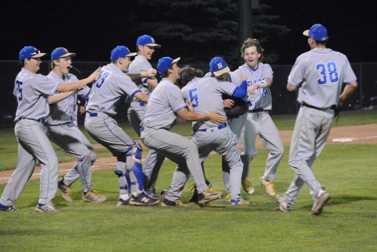 Newtown High baseball players celebrate winning the conference championship.