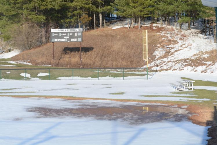 Late-March snow and ice prevented spring sports teams from holding tryouts and preseason practices on the softball and baseball fields.