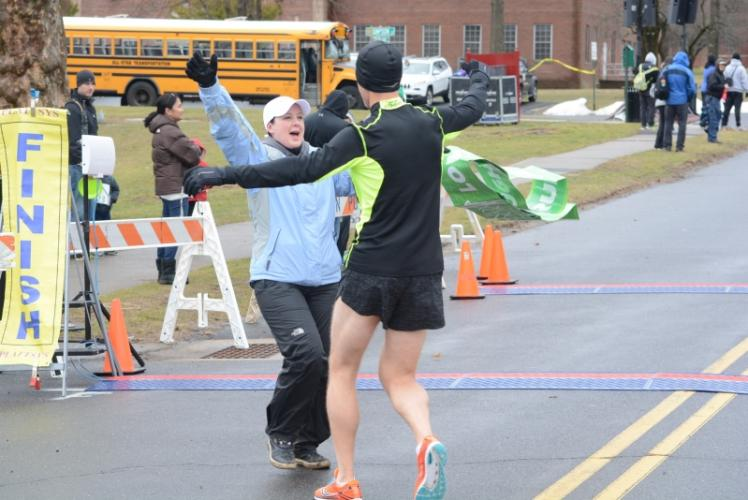 Sandy Hook 5K Race Director Katie Blake congratulates Kevin Boughan for winning the race on April 1. Mr Boughan is also a volunteer on the race committee. -Bee Photo, Hutchison