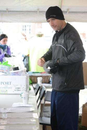 Kevin Boughan, a Sandy Hook 5K volunteer, posts race results for runners after the Sandy Hook 5K. -Bee Photo, Hutchison
