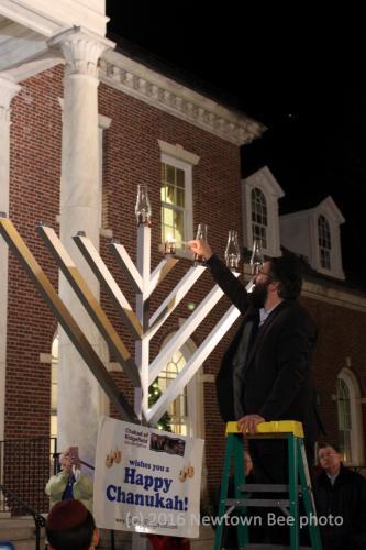 community-menorah-lighting-Rabbi-Deitsch-lighting-menorah-2016-Bee-file-photo-WATERMARKED.jpg