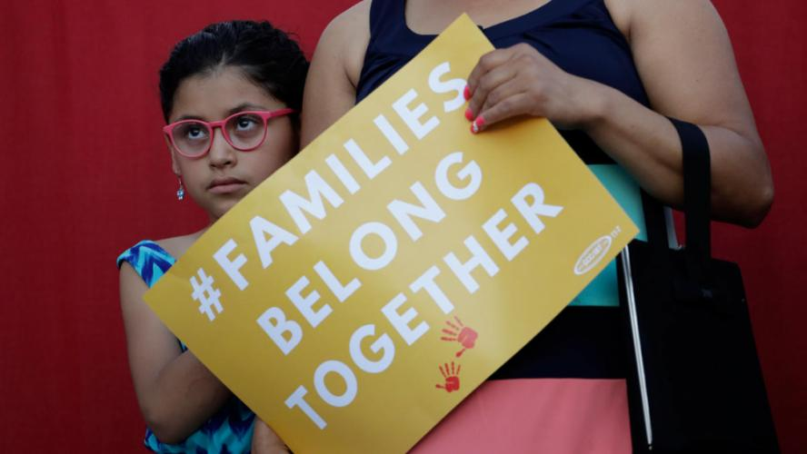 "In this AP image, a girl stands with her mother during a Rally For Our Children May 31 in San Antonio protesting the new ""zero-tolerance"" immigration policy that has led to the separation of families. A similar rally being organized by residents Jim…"