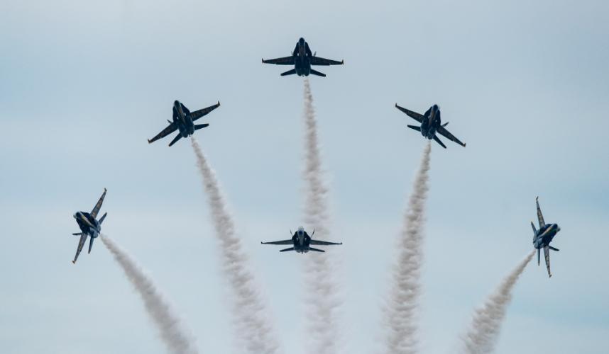 """The Blue Angels, America's naval aerobatic demonstration team piloting McDonnell Douglas F/A-18 Hornets perform their """"loop break crossover maneuver"""" at the 2018 Rhode Island National Guard Open House and Air Show."""