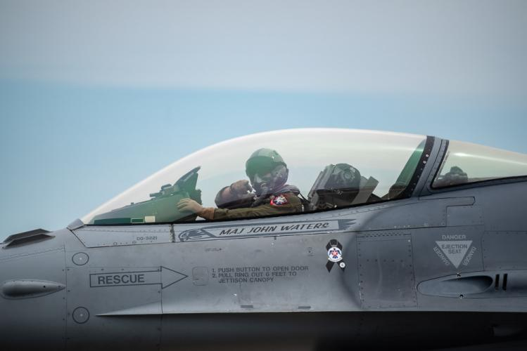 This F-16 Viper pilot points toward Newtown photographer Darrell Harrington while taxiing in after its flight demo. At the 2018 Rhode Island National Guard Open House and Air Show, the Viper did an individual demo, and it also as flew in the…