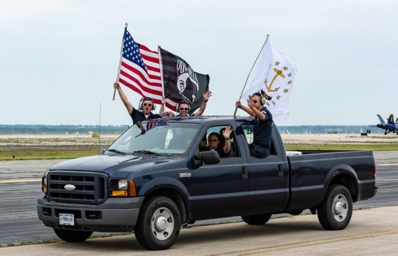 The Blue Angels ground crew drove past attendees as the jets taxi in - getting the crowd amped up.