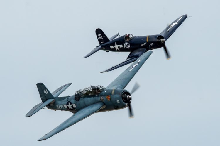 """These two planes were flown by the US Navy and Marines during World War II. The plane on the top right is a F4U Corsair which is painted with the phrase """"God Speed"""" in honor of John Glenn who flew one as a Marine during World War II. Many Corsairs…"""
